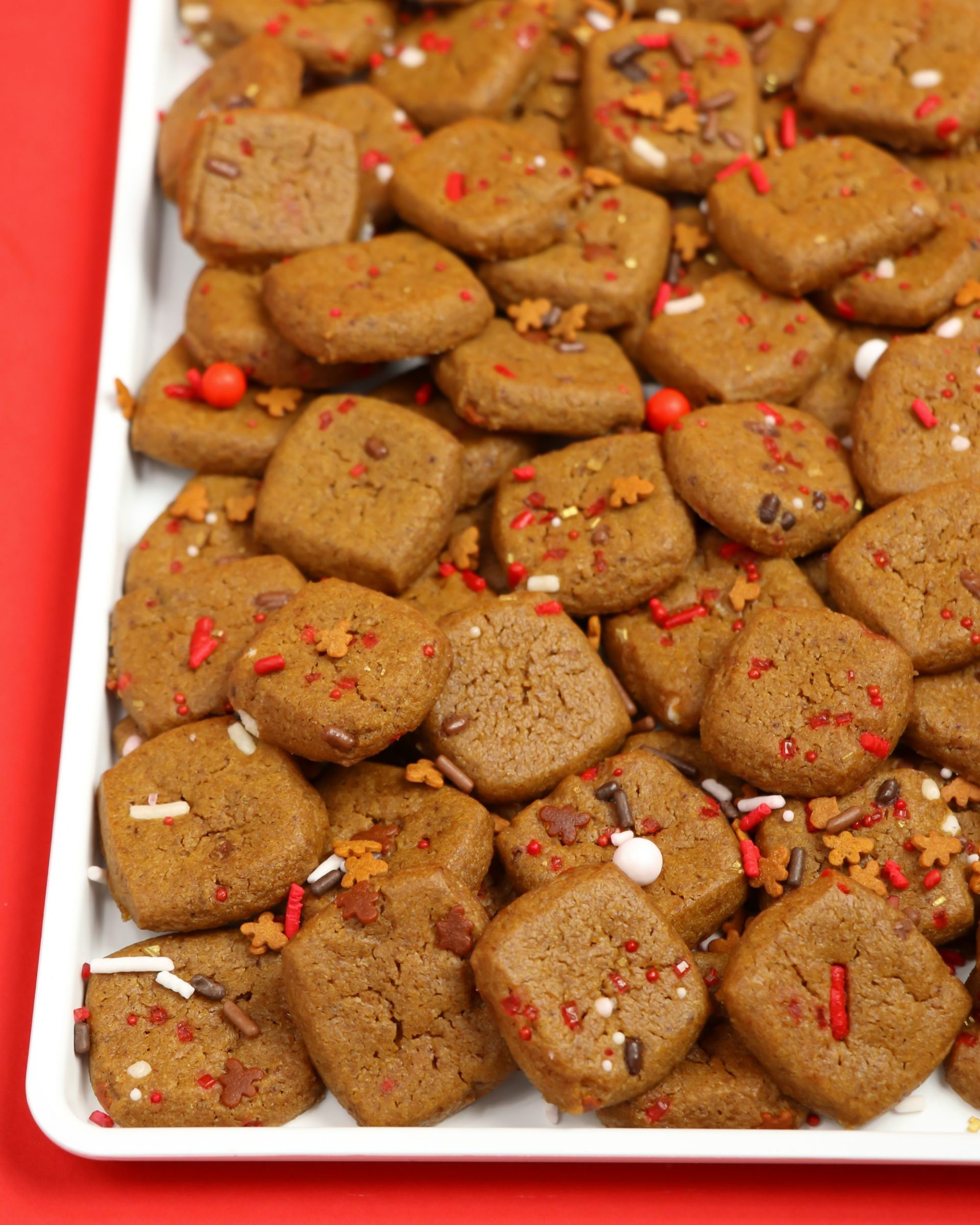 Gingerbread Cookie Bites! Cocoa & Cookies Christmas Party Ideas! This warm and inviting hot cocoa bar inspired party is all things winter! Put on your warm sweater and Christmas music and get ready for the holidays. With Gingerbread sweets and Reindeer Food sprinkles, you are all set!
