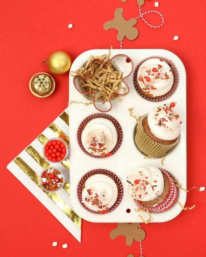Cocoa & Cookies Christmas Party Ideas - Gingerbread Christmas cupcakes in white pan on red background