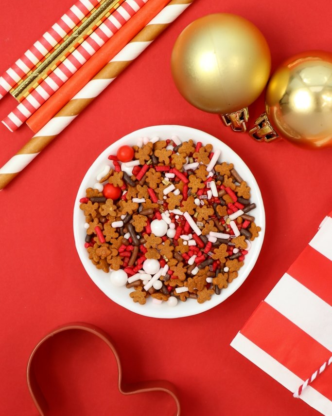 Cocoa & Cookies Christmas Party Ideas - Reindeer Food Christmas Sprinkle Mix in white dish on red background