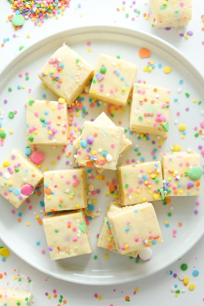 easy no bake cake batter fudge with sprinkles on white round platter