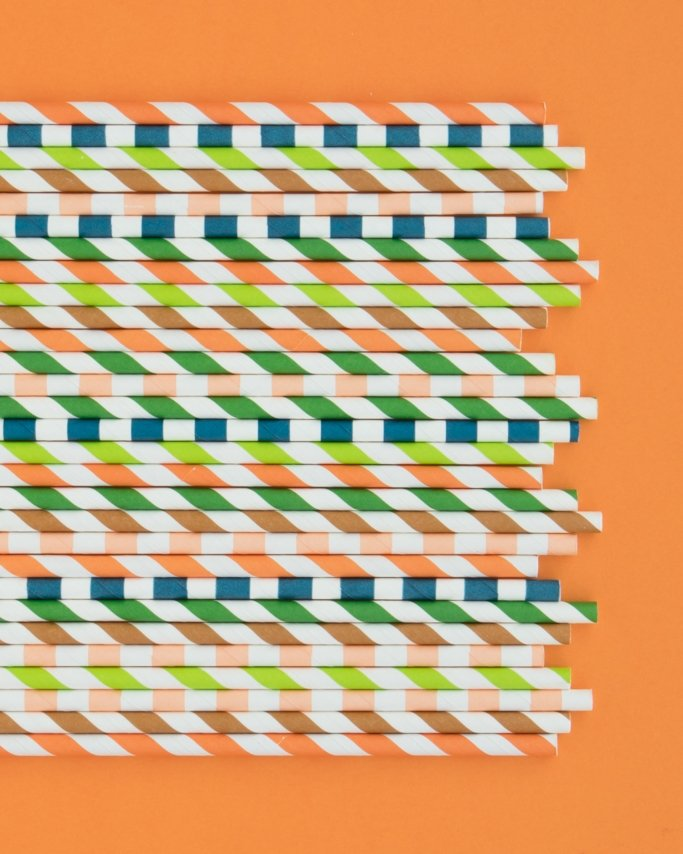 Dinosaur Birthday Party - Paper Straws assortment on orange background