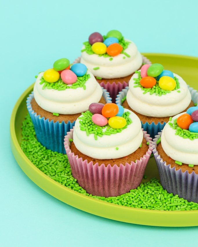 Easter Basket Cupcakes on green plate and light blue background