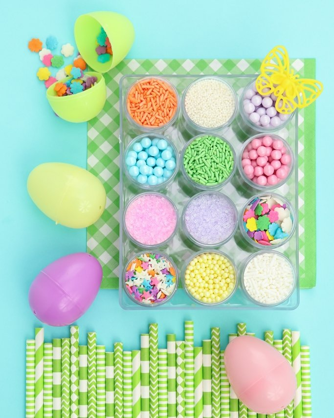 Pastel Easter sprinkles in a clear box kit and open easter eggs