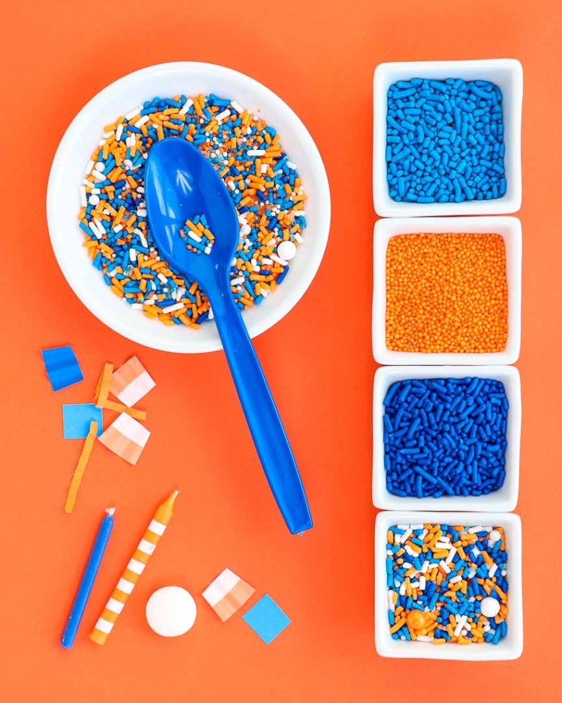 Nerf Party Sprinkles in separate solid white dishes on orange background