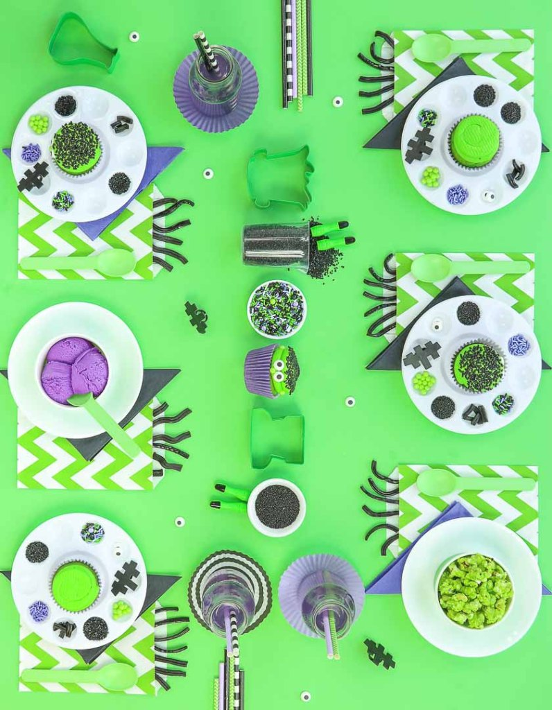 Frankenstein Kids Halloween Party Ideas - Party Table on lime green background