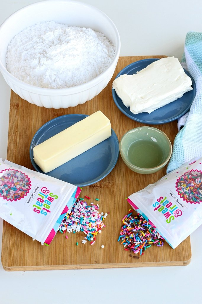 All the ingredients needed to make the best cream cheese frosting recipe laid out before the recipe is started.