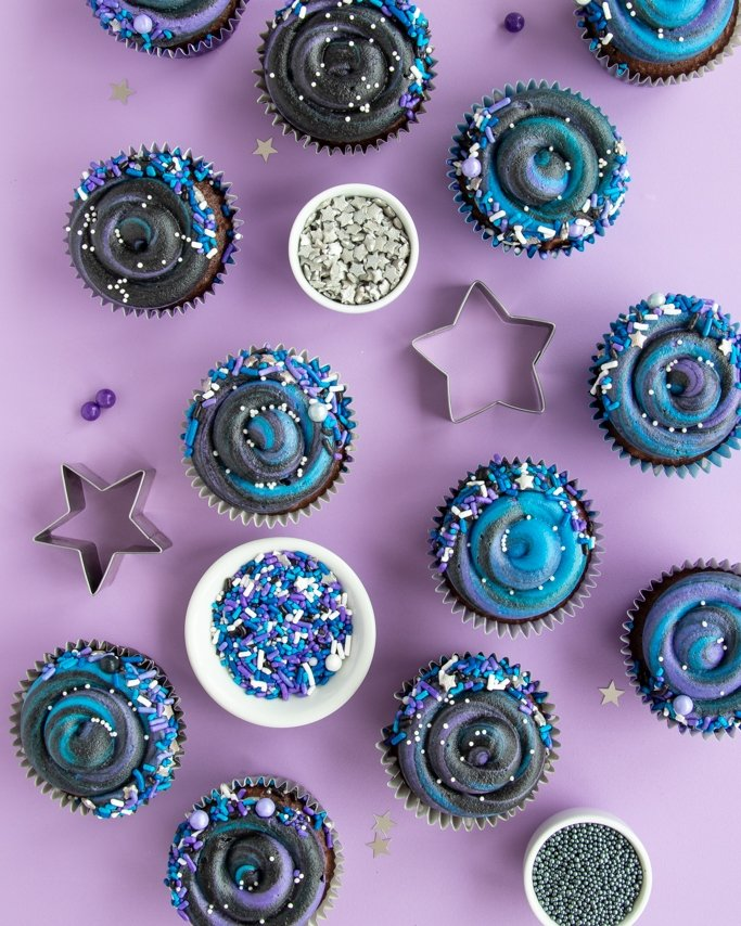 Swirly Galaxy Cupcakes Tutorial - DIY Outer Space Cupcakes - Galaxy Themed party cupcakes on light purple background with star quins sprinkles and star cookie cutters