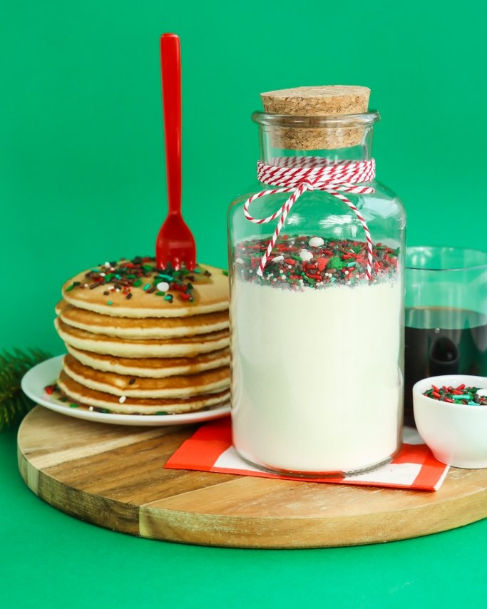 Lumber Jack Sprinkle Pancakes In A Jar - This sweet gift idea is great for Christmas or even for a pjs and pancakes party favor! It's a fun spin on the cookie mix in a jar gift ideas. We all love pancakes! Now, sprinkle pancakes are even better!