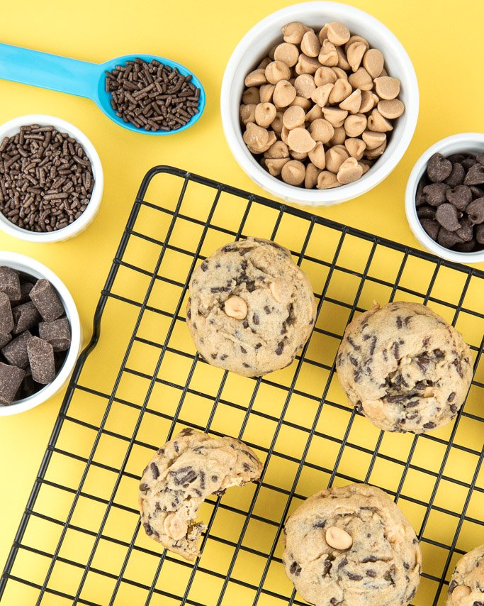 Peanut Butter Chocolate Chip Sprinkle Cookies! This classic flavor combo will be your new go-to cookie recipe. Thick and oh so chewy!