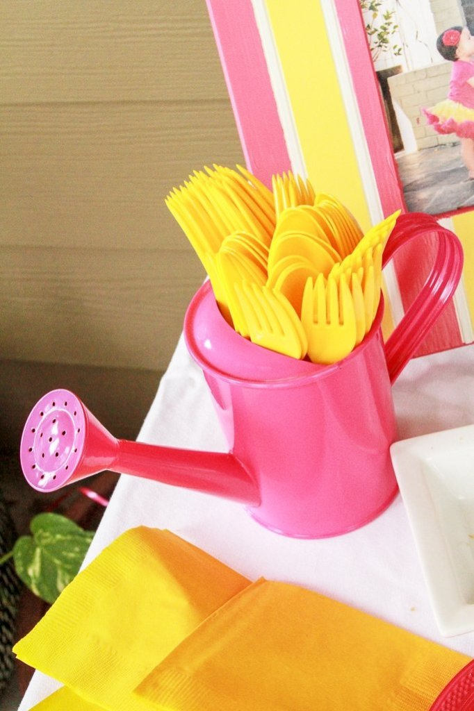 Pink Lemonade Party Ideas - Pink watering can filled with plastic silverware