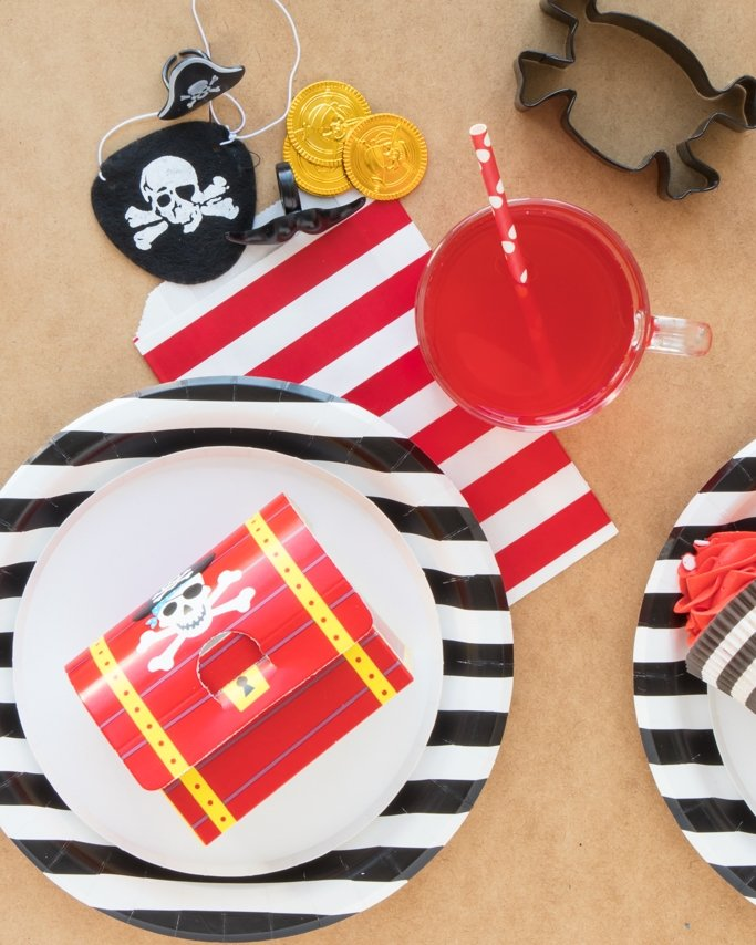 Pirate Party Ideas on stripe plates and tan sand background