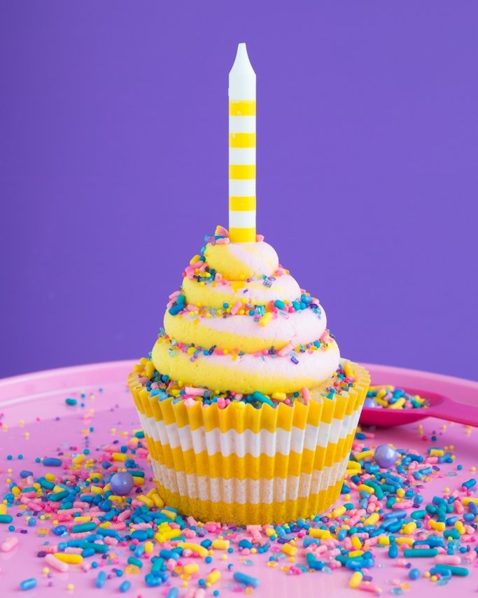 Shimmer and Shine Party Cupcakes on Pixie Dust sprinkles, pink cake plate, and purple background