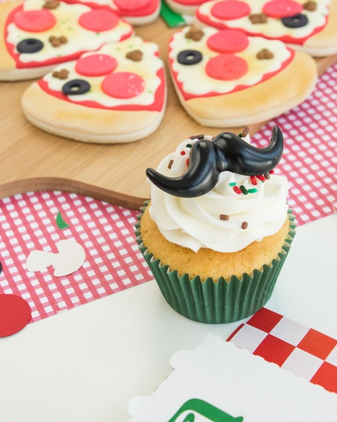 Pizza party with a pizza party cupcake.