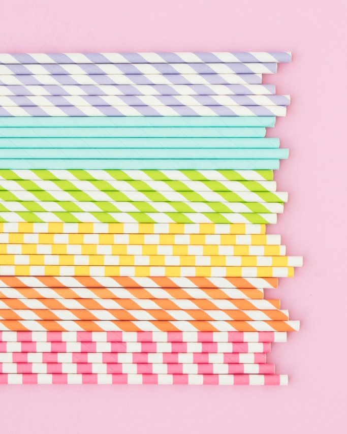 Rainbow Paper Straws in assorted patterns on pink background