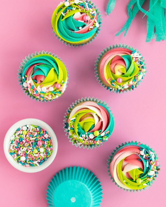BakeBright greaseproof cupcake liners with swirl cupcakes on pink background