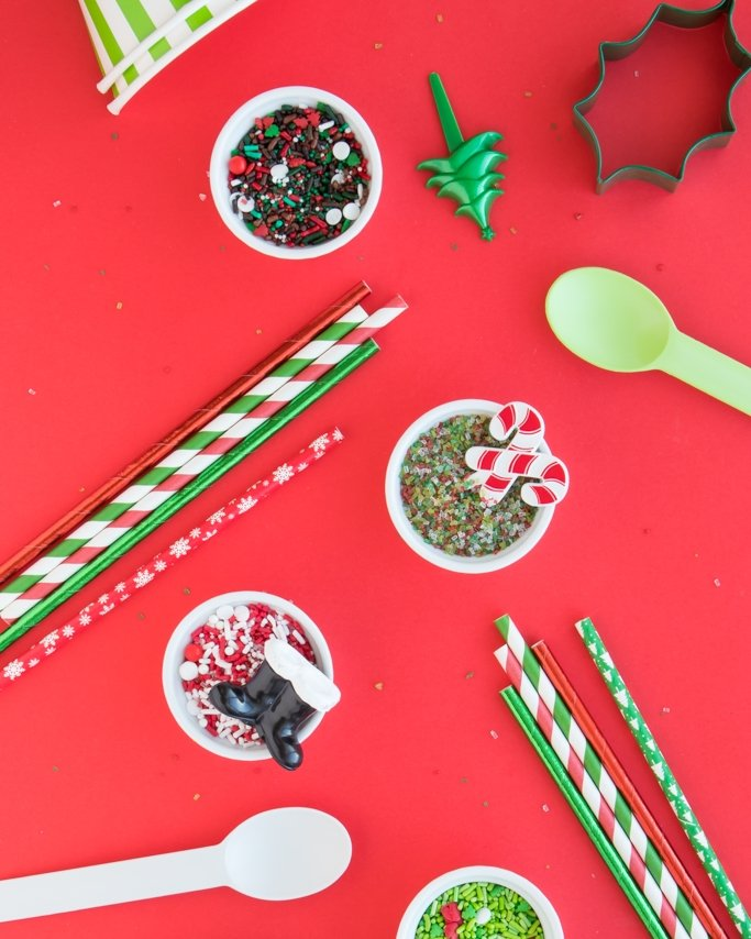 Traditional Christmas Sprinkles and Christmas Baking Supplies on red background