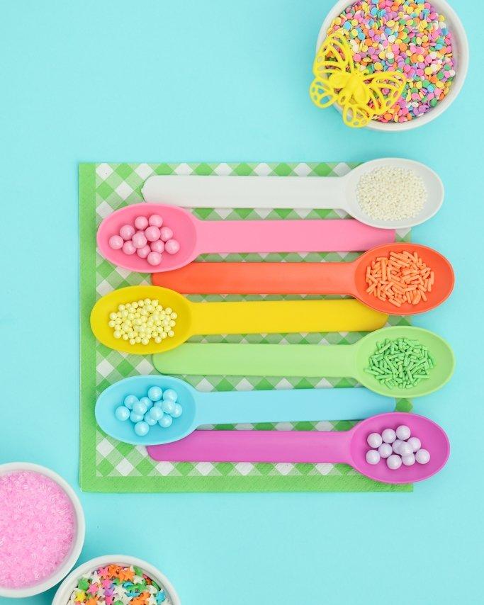 Pastel ice cream spoons with pastel sprinkles