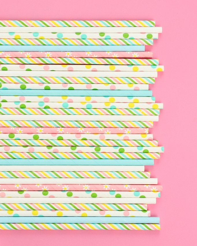 Assorted Easter paper straws on light pink background
