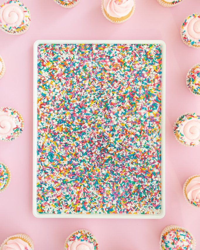 Birthday cake sprinkles in white dish for dipping cupcakes