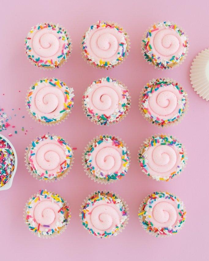 Swirl sprinkle cupcakes rolled in birthday cake sprinkles