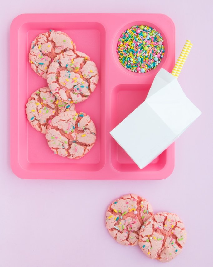 Strawberry Cake Mix Cookies with sprinkles on pink school lunch plate