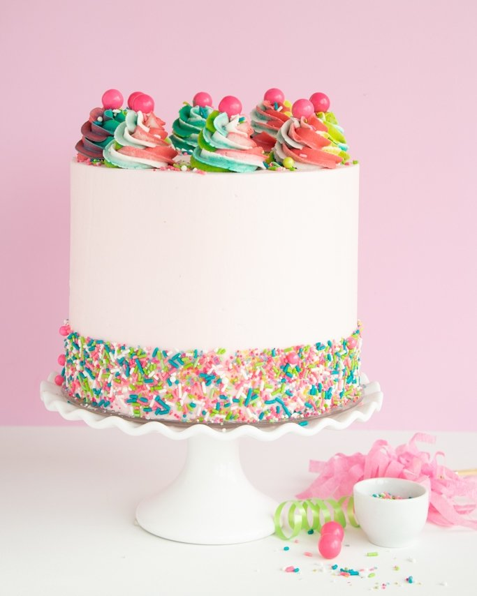 Buttercream Cake with Sprinkle Band and swirl cake topper frosting