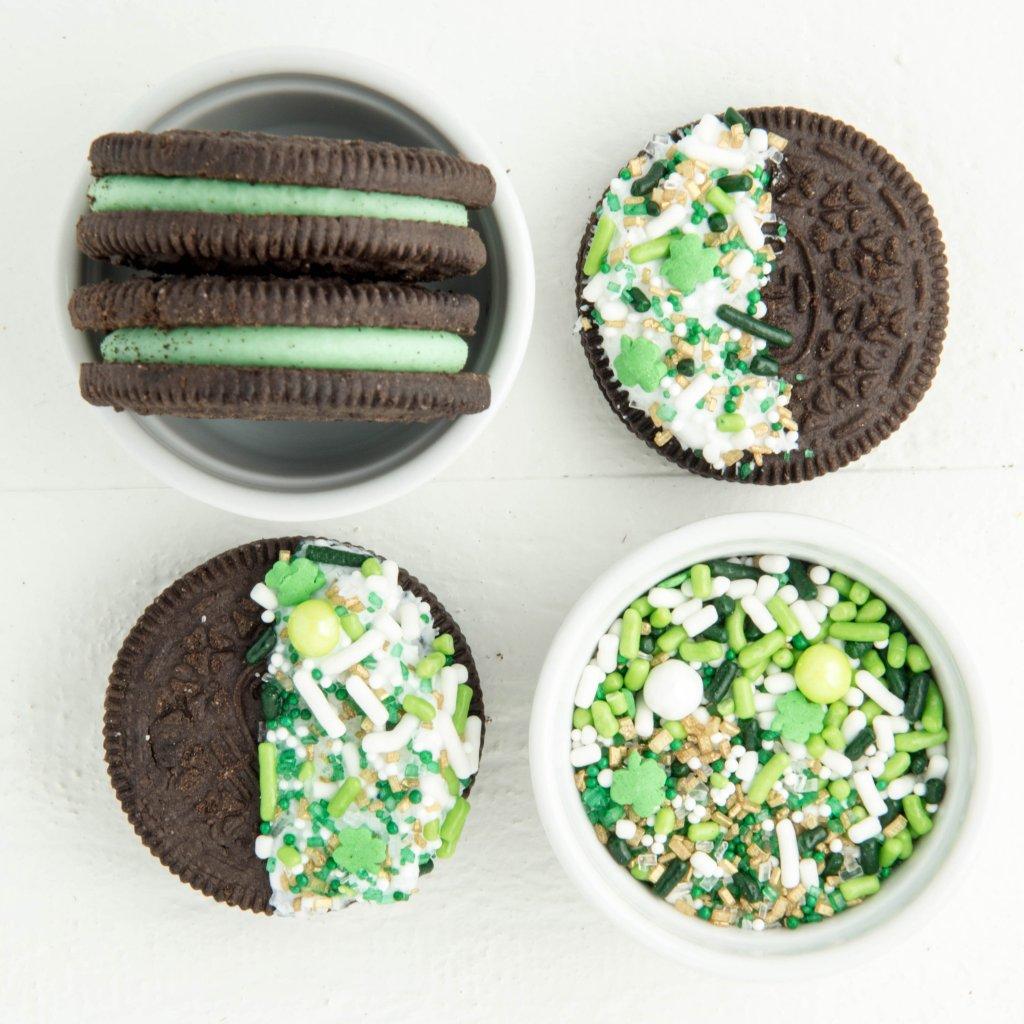 St. Patrick's Day easy cookies - Sprinkle Dipped Oreos. Topped with our Lucky Charm sprinkle mix, this is one of the fastest and easiest desserts around.