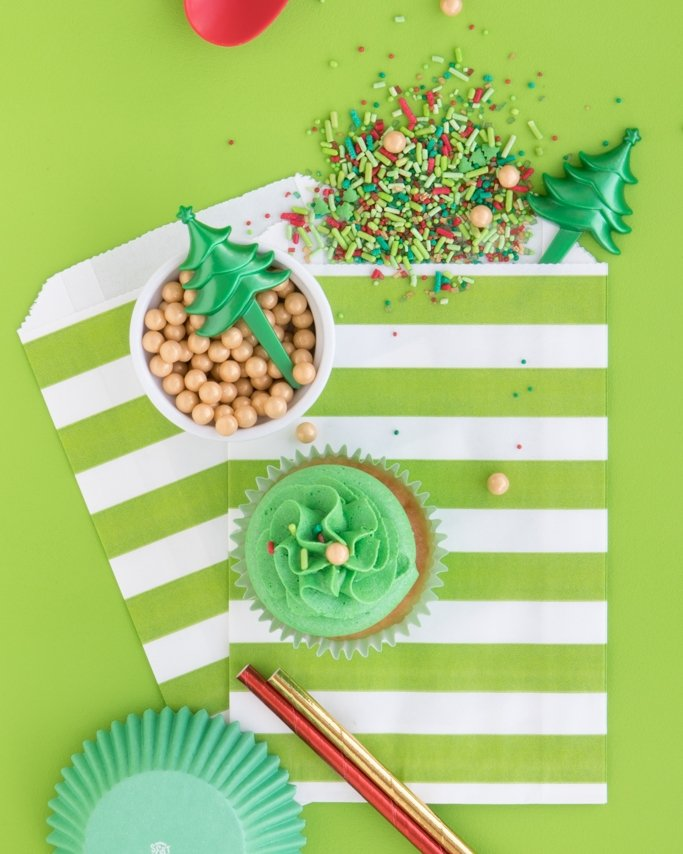 Christmas Sprinkle Mix & Christmas Baking Supplies on lime green goodie bags and green background