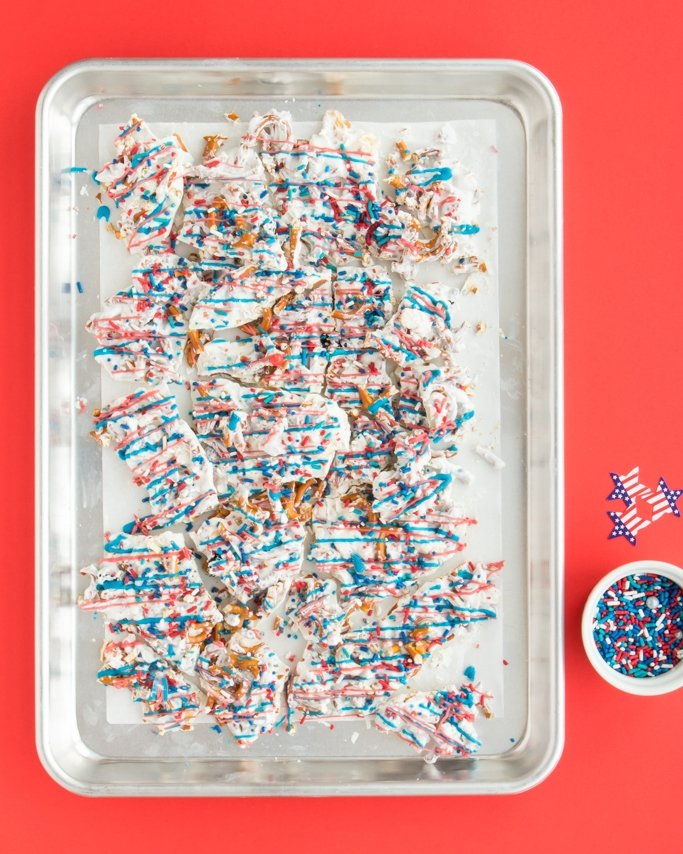 Patriotic White Chocolate Pretzel Bark - Easy 4th of July Dessert on silver baking pan.