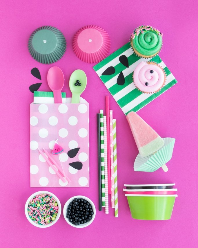 watermelon party supplies on pink background