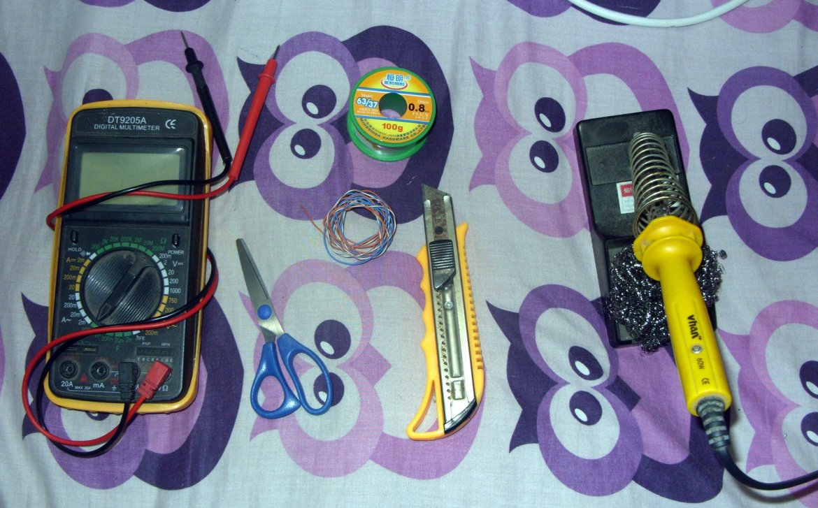 From left to right Multimeter, Scissor, Cutter, Soldering Iron with stand and tip cleaner, And soldering lead at top