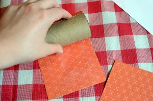 Roll the red paper around the outside of the toilet paper roll