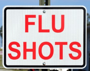 Flu Shots sign bolted to post