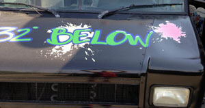 Fig 2: Fluorescent vinyl is not a good choice for graphics on the hood of a black truck