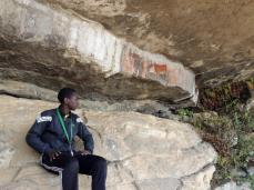 Rock art custodian and guide from the local community. To visit one of the open sites you have to be accompanied by a trained custodian. This is to protect the rock art from damage and supports the local community.
