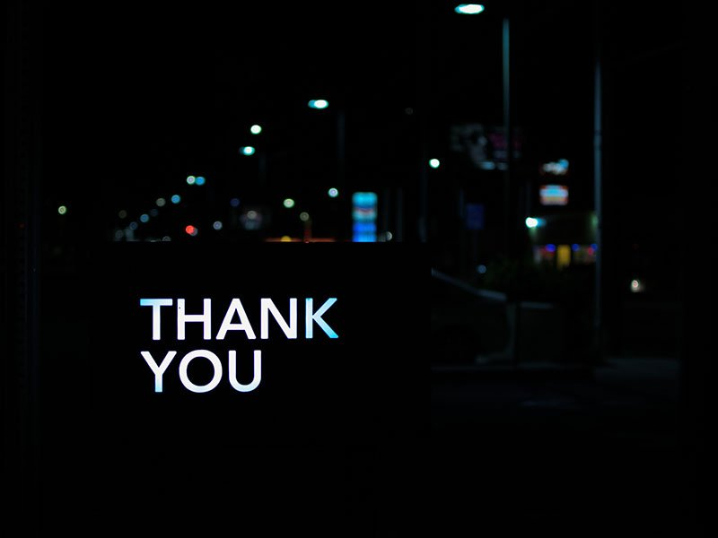 A light up sign that says thank you.