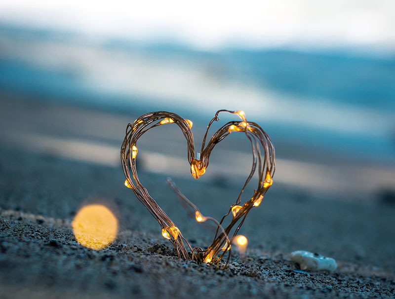 A string of lights shaped into a heart.