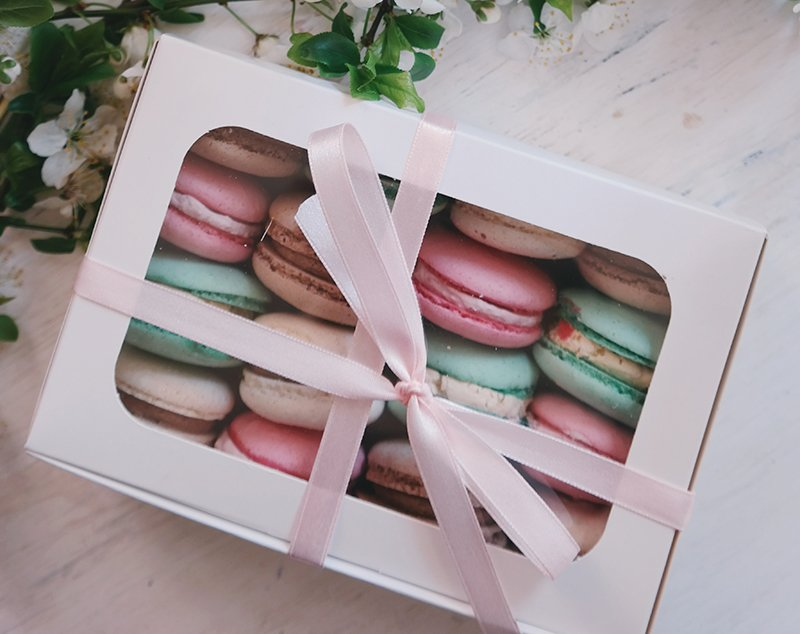 A box of macarons tied with a bow.
