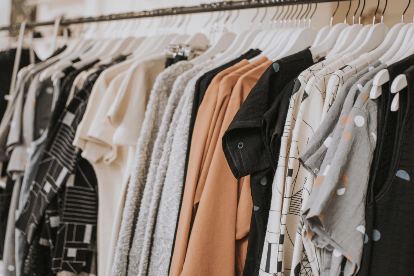 Rack of hanging clothing