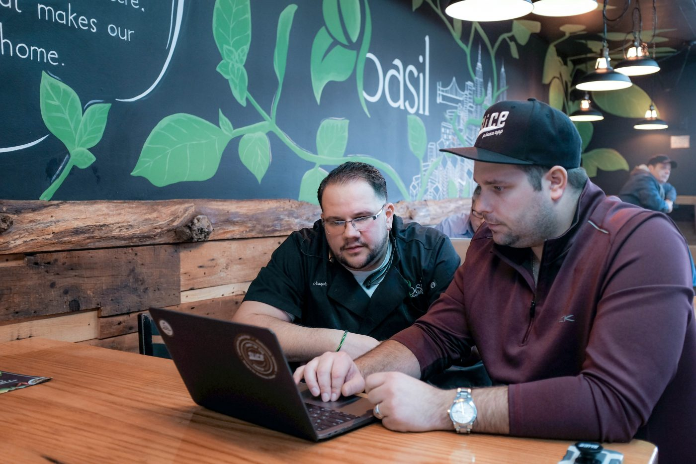 Slice employee helping owner with his Google My Business