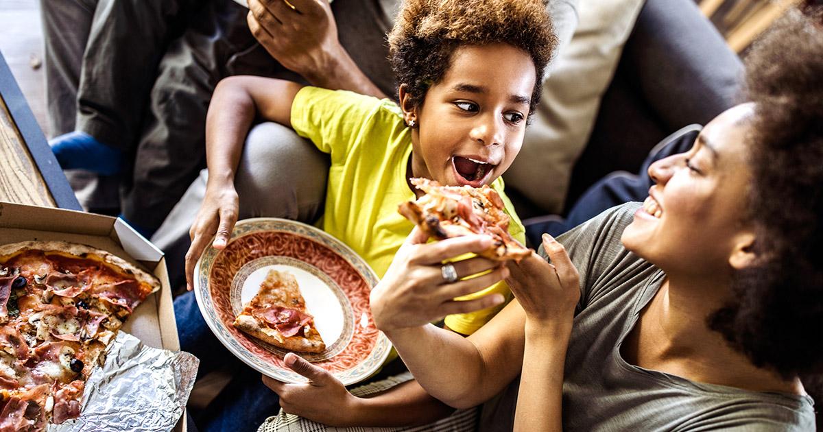 Family Eating Pizza Slice