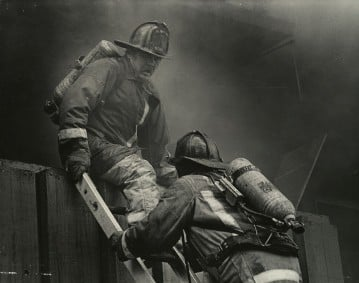 Firemen fight three-alarm fire in Houston in 1986.