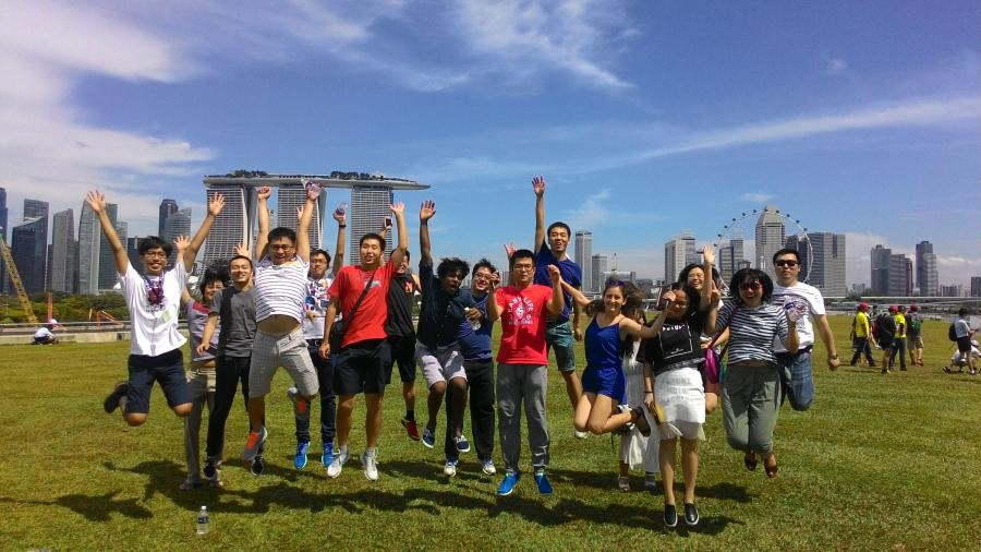 1st year SMU PhD students try out the signature SMU Jump against the Singapore city skyline