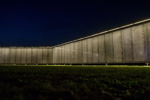 Night view with lights of The Wall That Heals by Creatacor