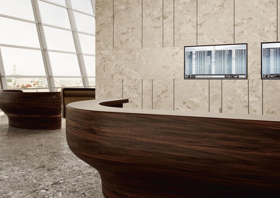 Corian® Solid Surface Reception Desk in Mahogany Nuwood.