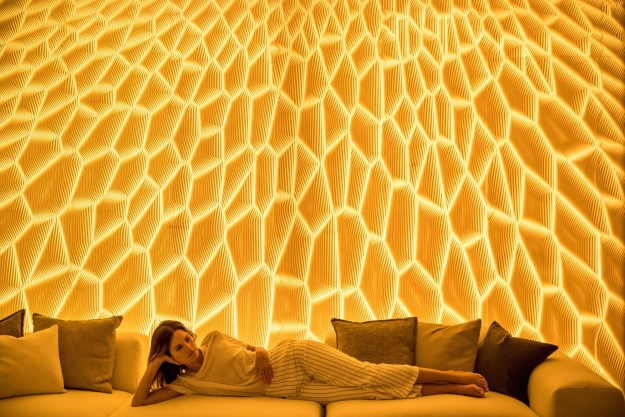 """Corian® Design showcased these multi-dimensional wall systems, by designer Mario Romano, that looked as if they were carved. (""""HONEY,"""" photography courtesy of Mario Romano.)"""