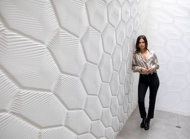 """""""HIVE"""" wall, exterior solid surface patio wall by M.R. Walls (photography courtesy of Mario Romano)."""