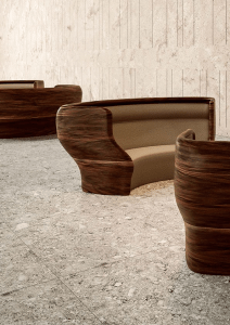 Thermoformed solid surface benches in Mahogany Nuwood from Corian®