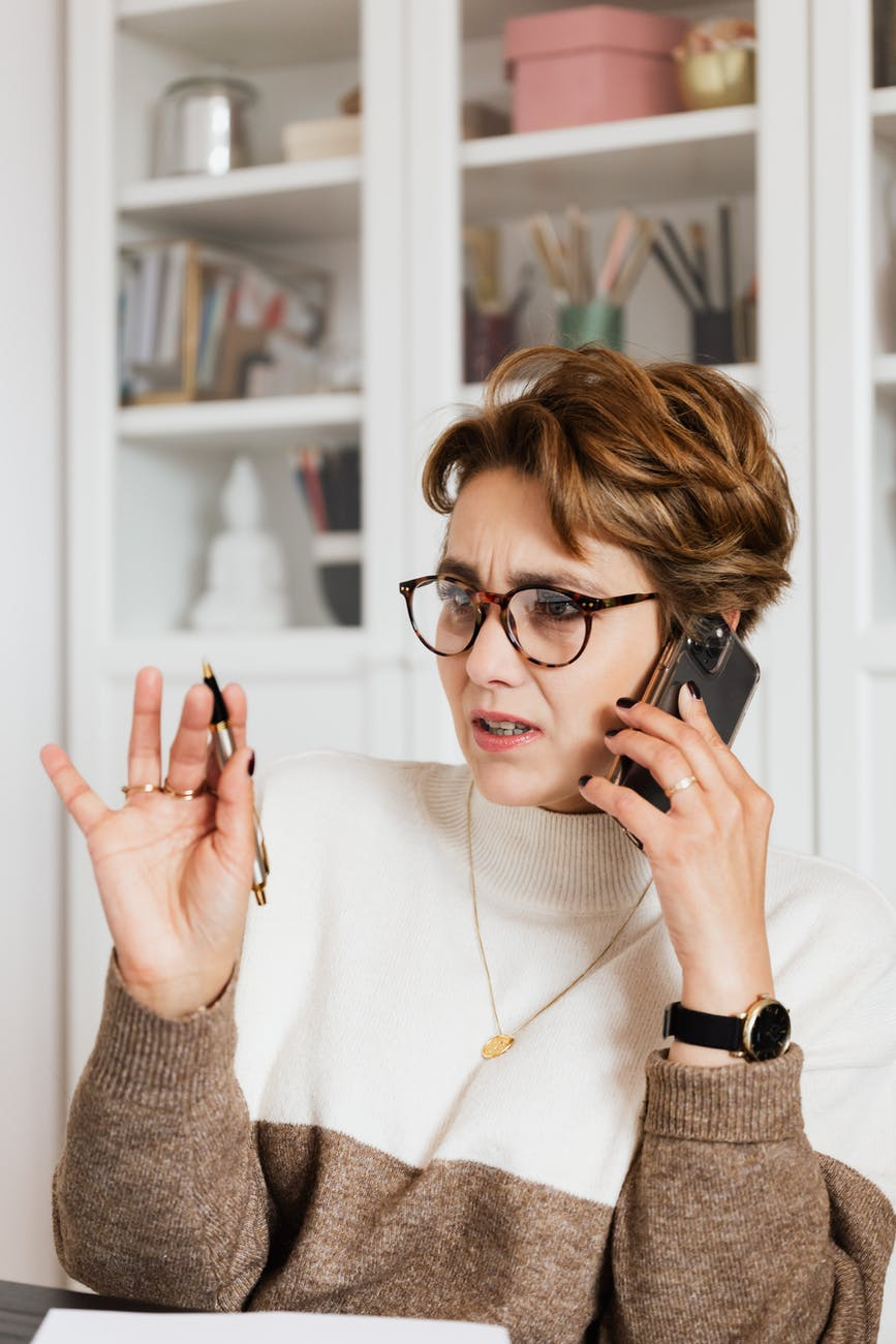 woman talking on phone with confused face