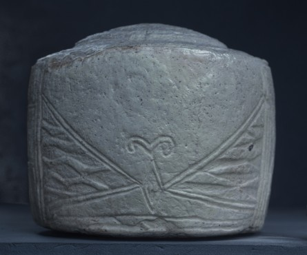 Evidence of an erased 'eyebrow' above the central motif on drum 2
